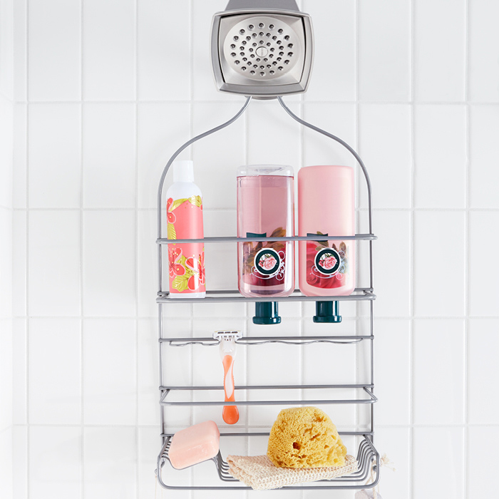Vertical subway tile and shower caddy.