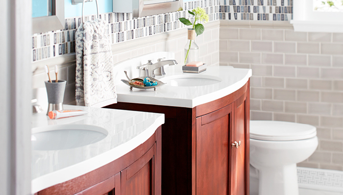 Curved-front bath vanities.